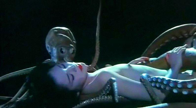 Small octopus kissing woman