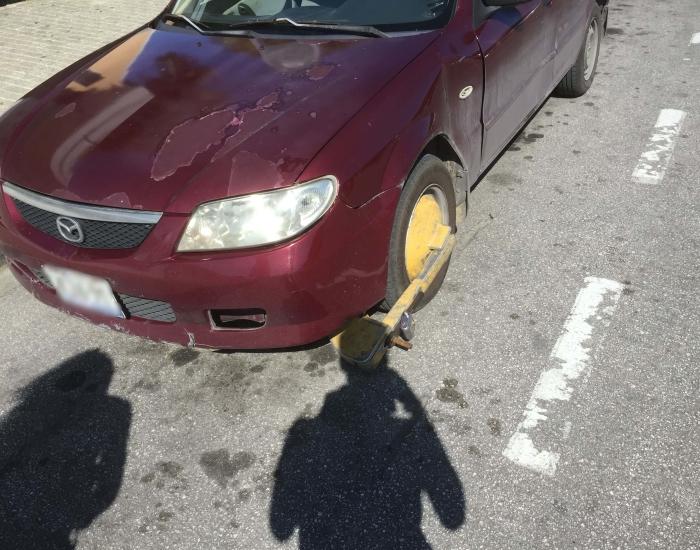 Er zit een wielklem op mijn auto op Curaçao - Wat moet ik doen?